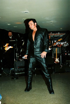Mike as Elvis with black leather costume